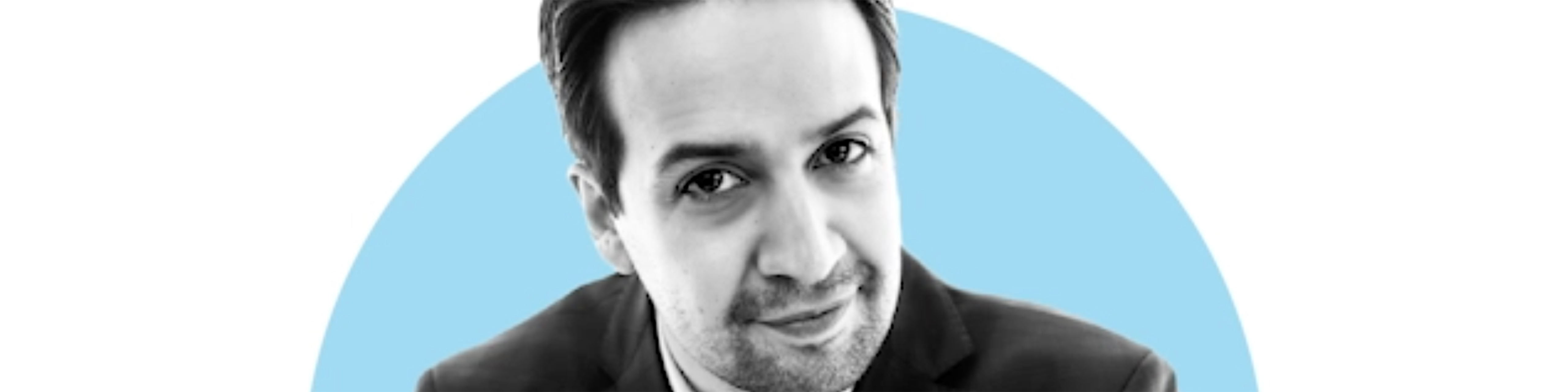 black and white screenshot of lin-manuel miranda on a blue and white background
