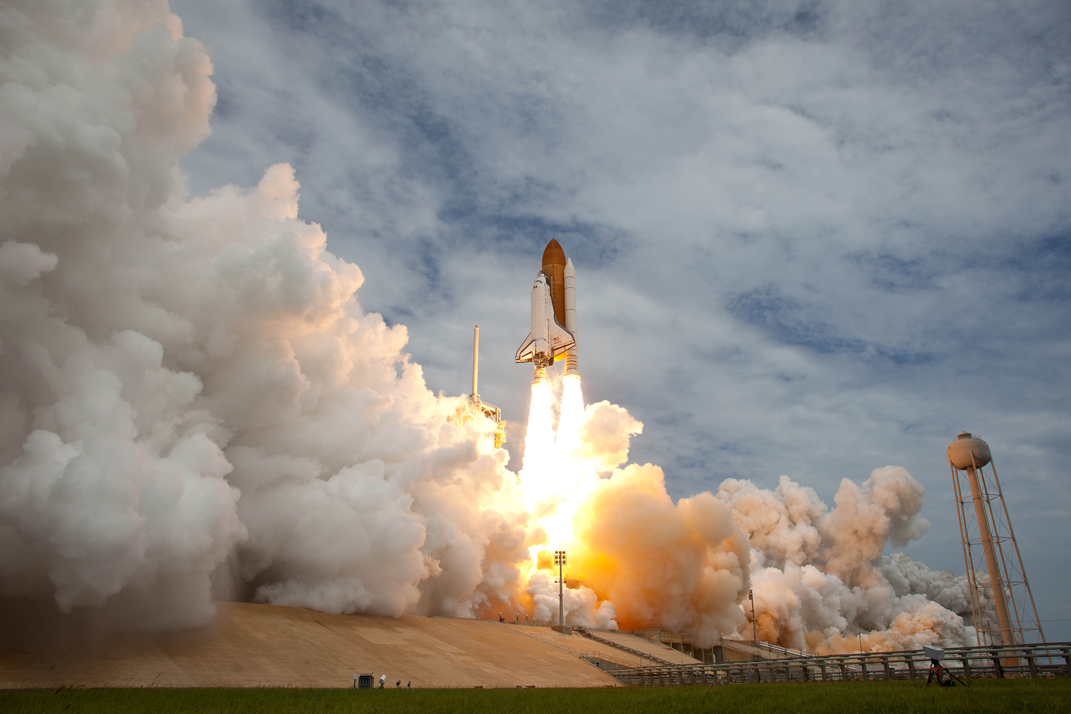 photo of space shuttle atlantis blasting off