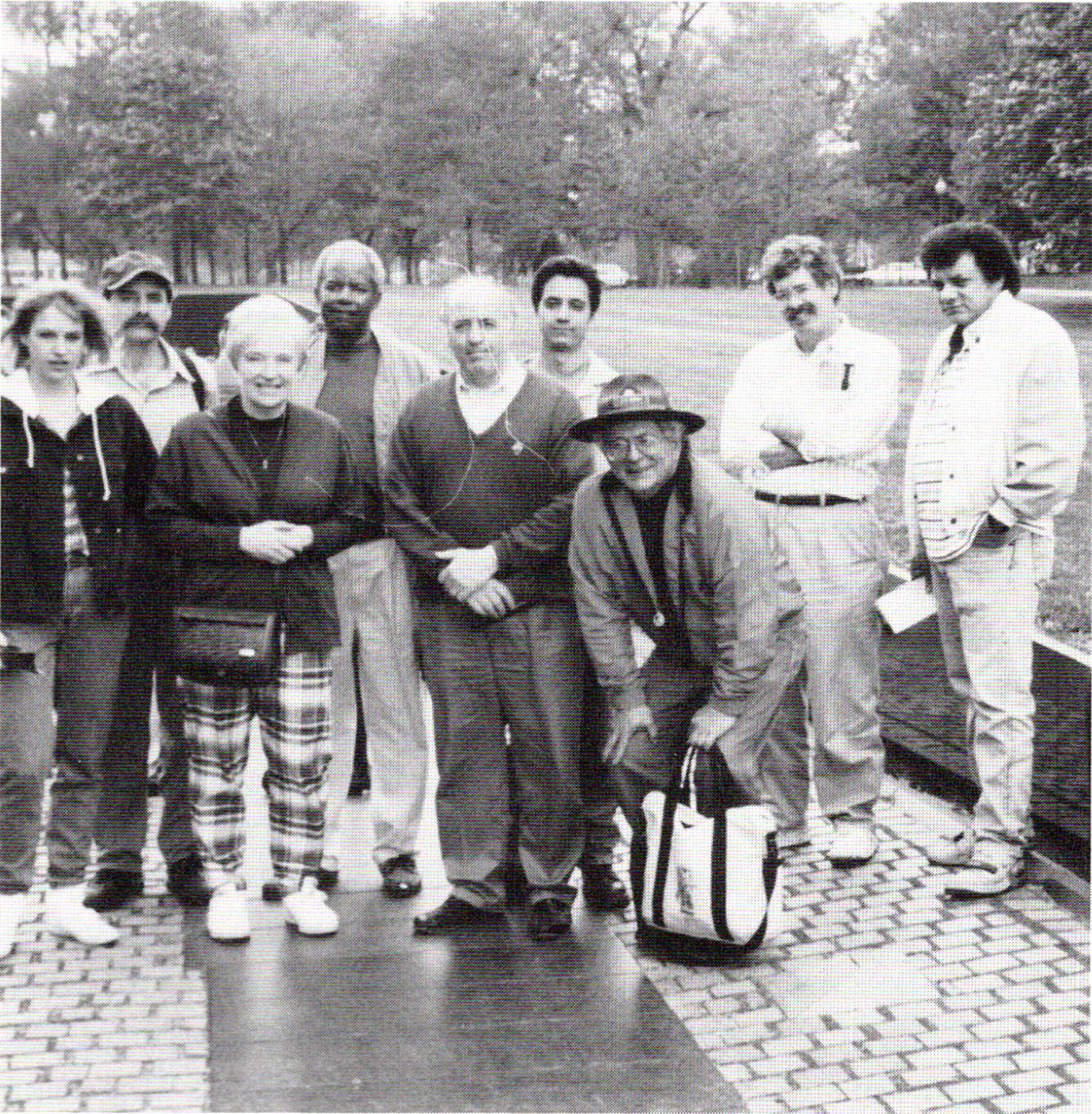 Black and white images of students young and old posing with their teachers at the Vietnam Veterans Memorial