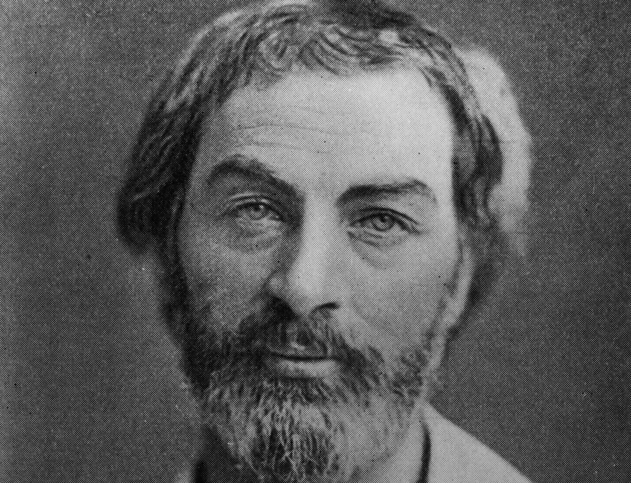 black and white portrait of a young walt whitman