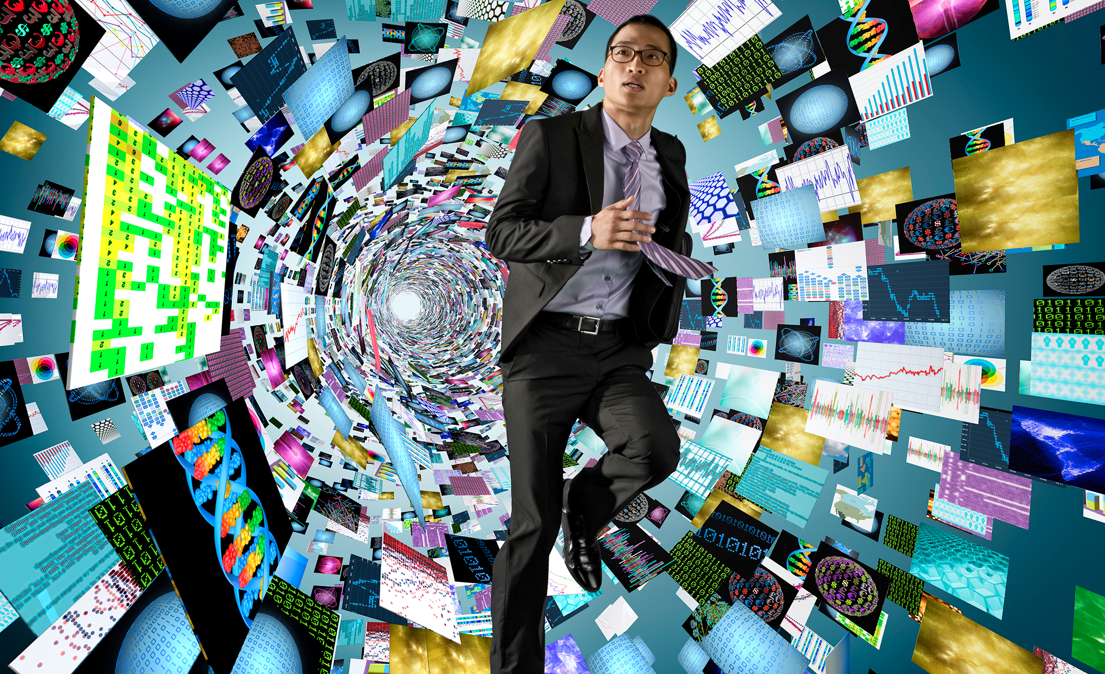 A man in suit runs through a tunnel of screens and information
