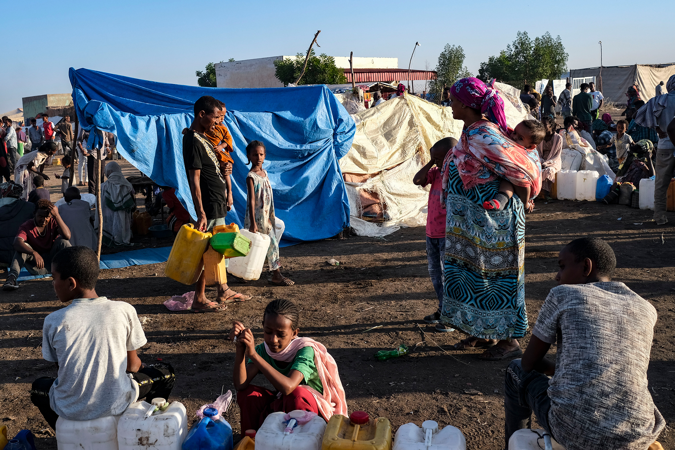 Photograph of refugees in tents and mats
